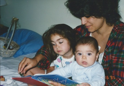 Janel reading to her children Jena '03 and Harper '07