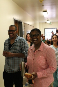 K/1 Lead Teacher Joe Braxton shares a laugh with Walden parent Dwana Willis